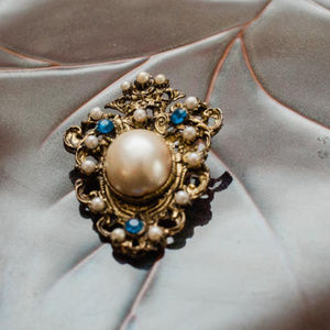 Vintage costume brooch, pearl and blue stone